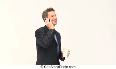 Businessman talking on the phone during a coffee break against a white background