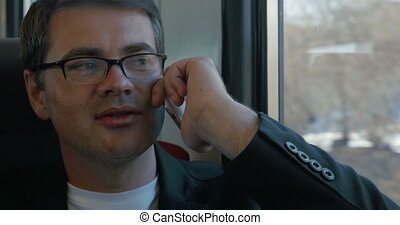 Businessman Talking on the Phone in Train