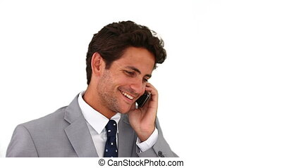 Businessman talking on the phone isolated on a white...