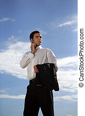 Businessman talking on the phone outdoors