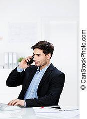Businessman talking on the telephone