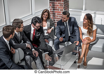 businessman talking to his business team