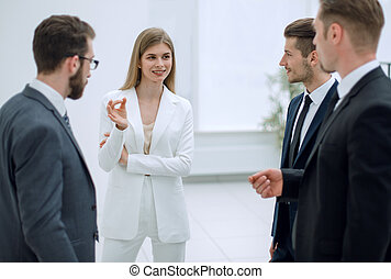 businessman talking to the business team