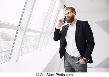 Businessman talking to the phone in office