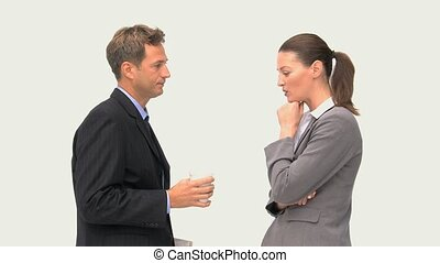 Businessman talking with a businesswoman