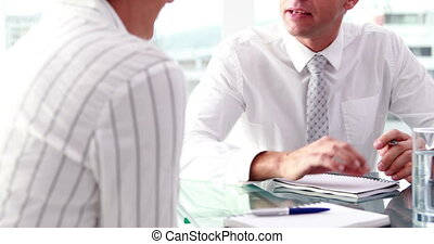 Businessman talking with colleague