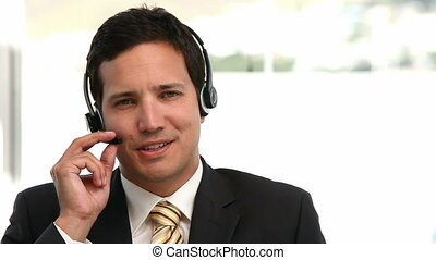 Businessman talking with headphone