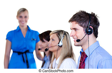 Businessman talking with headset in a call center