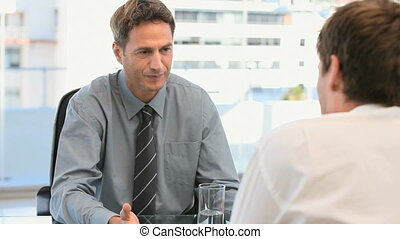 Businessman talking with his coworker