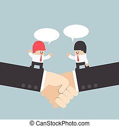 Businessman talking with partnership on a handshake