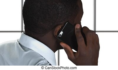 Businessman talking with smartphone.