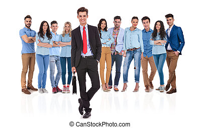 businessman team leader standing in front of his casual team