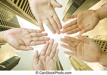 Businessman teamwork with hand together in middle of office ...