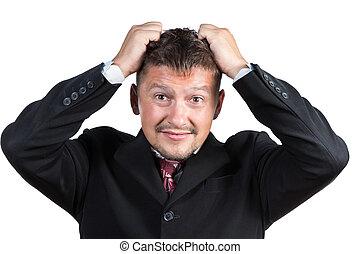 Businessman tearing his hair