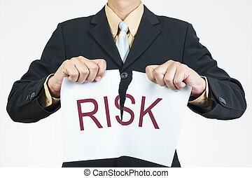 Businessman tearing sheet paper, risk management concept