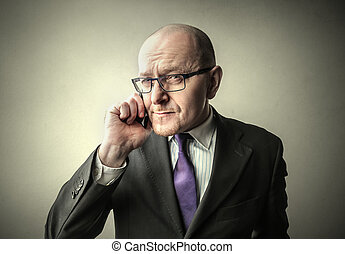 Businessman telephoning
