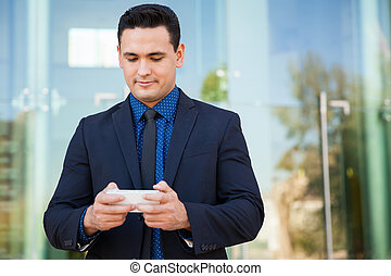 Businessman texting at work
