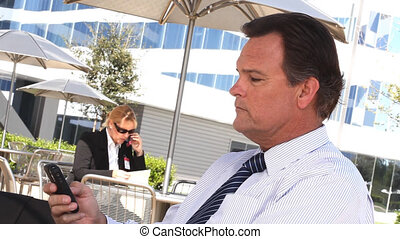 Businessman Texting on Cell Phone Outdoors