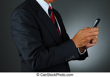 Businessman Texting With Both Hands