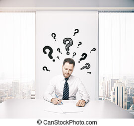 Businessman thinking about answers - Businessman in office...