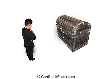 Businessman thinking and looking at old treasure chest