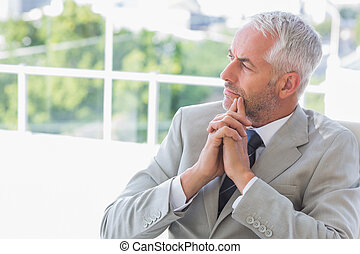 Businessman thinking in his office