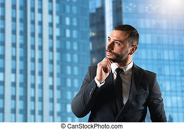 Businessman thinks new strategies to grow up the company