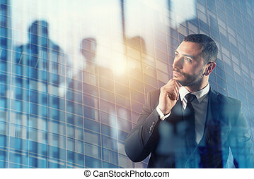 Businessman thinks new strategies to grow up the company. double exposure