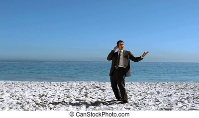 Businessman throwing his mobile in