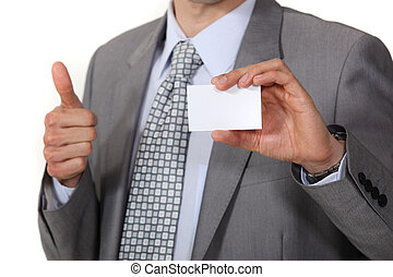 businessman thumb up showing business card