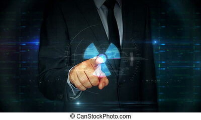 Businessman touch screen with nuclear energy symbol hologram...