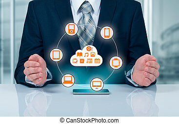 Businessman touching a cloud connected to many objects on a...