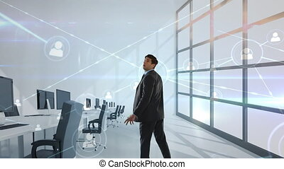 Rear view of animation of businessman touching a screen showing holograms in an office