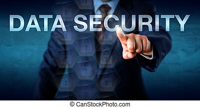 Businessman is touching the words DATA SECURITY onscreen. Technology and business concept for information security, data confidentiality, access control and computing authentication measures.
