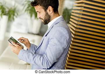 Businessman touching digital tablet and checking data