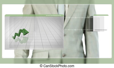 Businessman touching green graphic