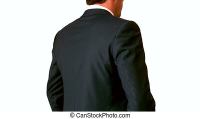 Businessman touching his painful lower back in slow motion