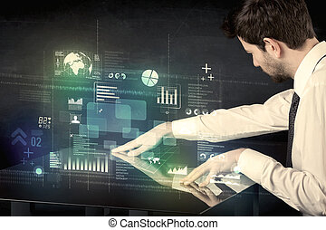 Businessman touching interactive modern desk with technology icons