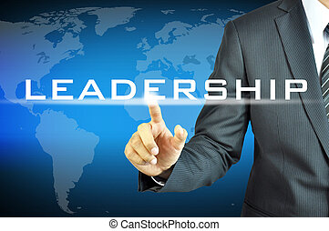 Businessman touching  LEADERSHIP sign on virtual screen