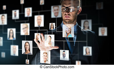 businessman touching screen with contact icons