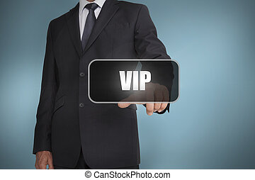 Businessman touching the word vip on blue background