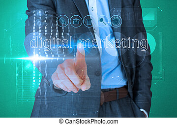 Businessman touching the words digital marketing on...