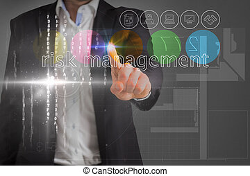 Businessman touching the words risk management on interface...
