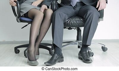 businessman touching to the knee him sexy secretary. Office ...