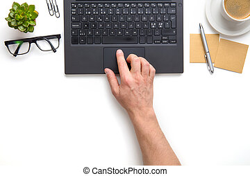 Businessman Touching Touchpad On Laptop At White Desk -...
