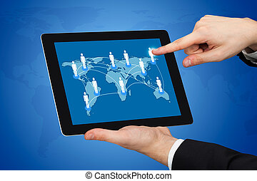 Businessman Touching World Map On Digital Tablet