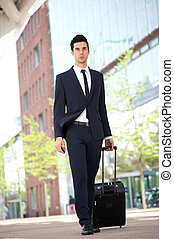 Businessman traveling with bag
