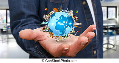 Businessman travelling the world - Businessman holding the...