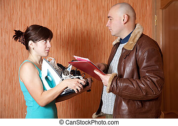 businessman trying to collect debt from woman