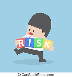 Businessman trying to manage risk block